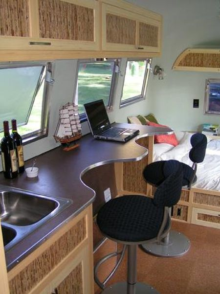 Completely Eco Friendly Airstream Glamping Trailer. The trim is bamboo. Love it!