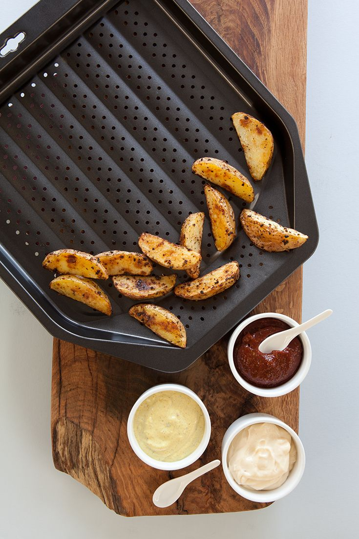 Oven Fries & Dips: Citrus Chipotle Ketchup, Roasted Garlic Aioli, & Mango Curry