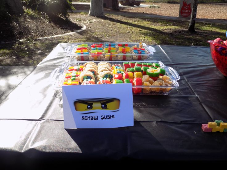 Sensei Sushi!  We used rice krispie treats, fruit roll ups, Swedish fish and rainbow colored licorice ropes to create these fun treats. To my surprise, they were the most popular item at the party - for BOTH adults and kids!