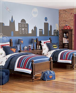 I love the idea of putting the symbol of the favorite superhero on each bed to distinguish them... Love this!