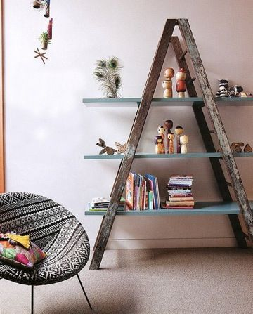 """Utilize the rungs on both sides of a folding ladder and attach plywood shelves... Paint the shelves with a durable semi-gloss finish for a nice contrast with the weathered wood."""