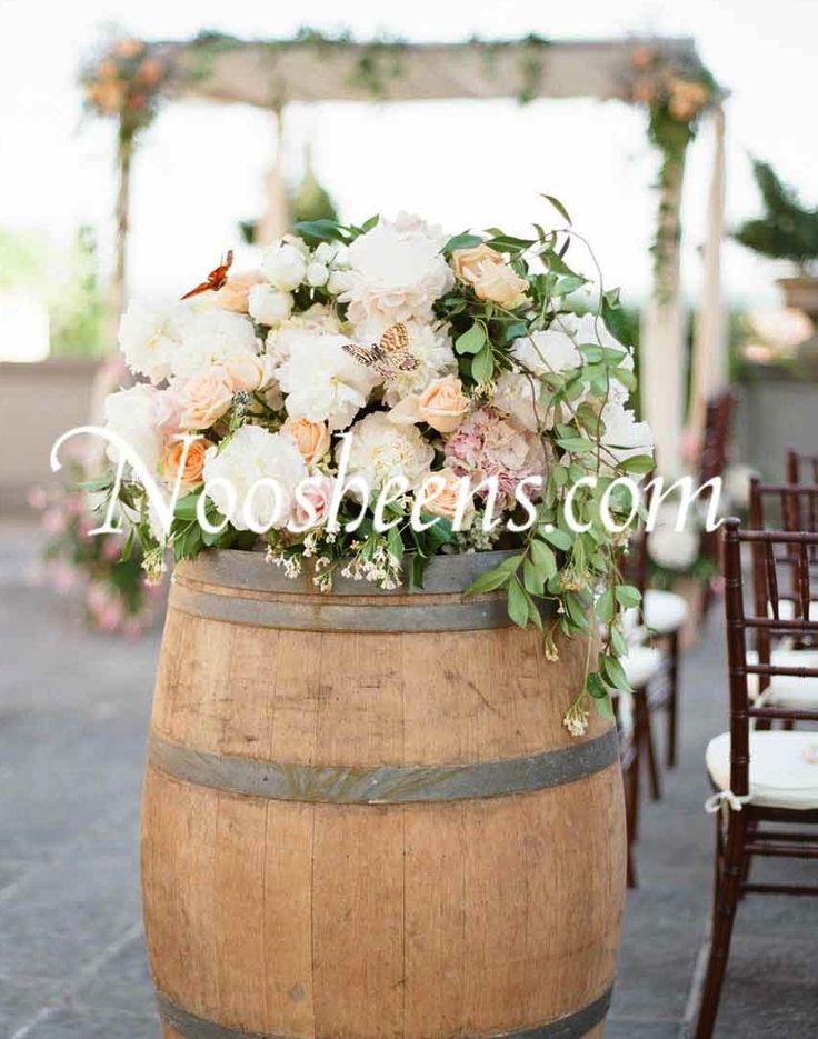 #Tuscan dream #wedding with simple #canopy draped fabric florals and organic barrique floral arrangement. #noosheens.com #www.noosheens.com @noosheensfloralco