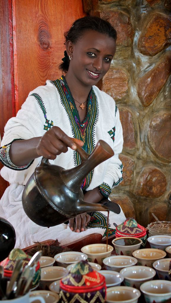 "Ethiopian Coffee Ceremony - Woman wearing traditional hand embroidered ""Telefe"" dress from Gonder."