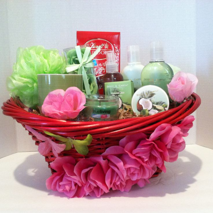 (Spa Gift Basket) Indulge in paradise you will feel like you have gone on a retreat! with scented coconut lime  (2) Sponge, Candle,  Cup,  Soap Rose Petals,  Shower Gel,  Body Lotion,  Body Spray,  Body Scrub,  Bath Salt,  Lindt Lindor Irresistibly Smooth Milk Chocolate Truffles.