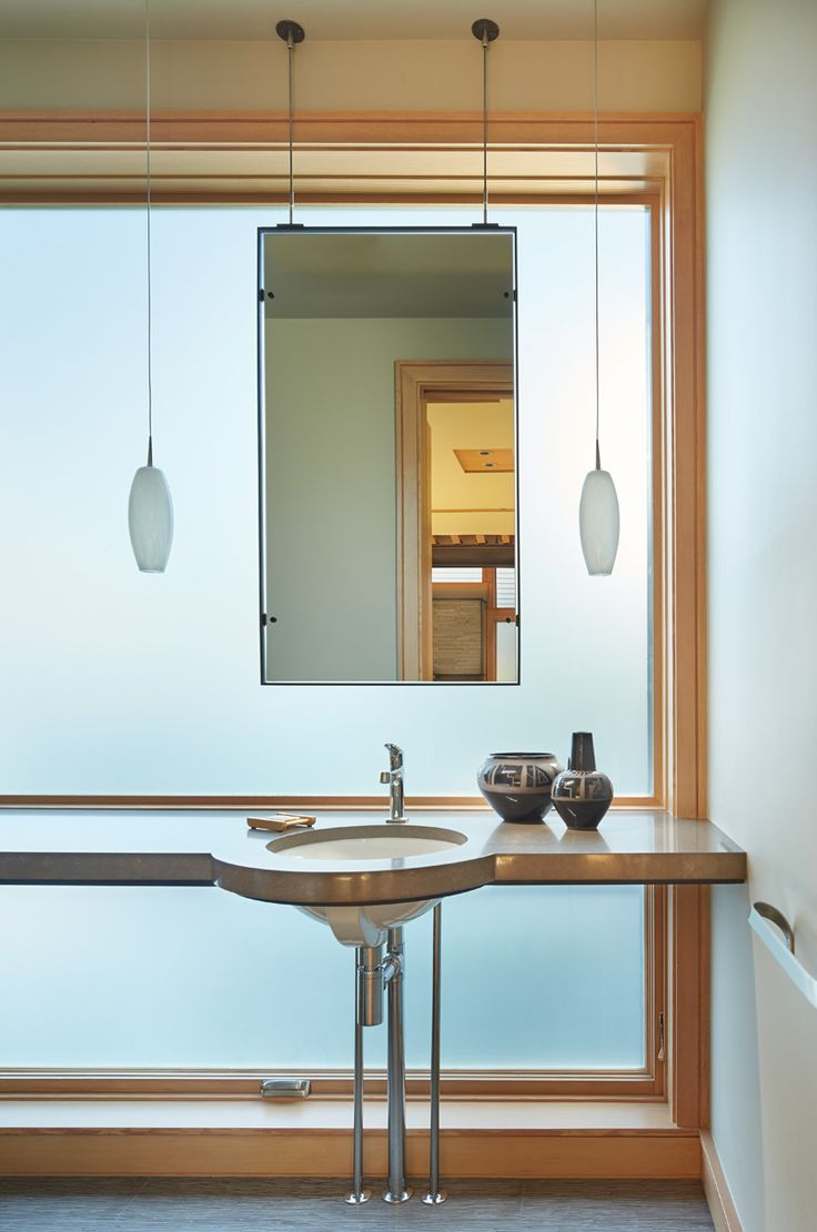 Love the sleek contemporary sink and pendant lighting in this relaxing bathroom on Elliott Bay in Seattle.