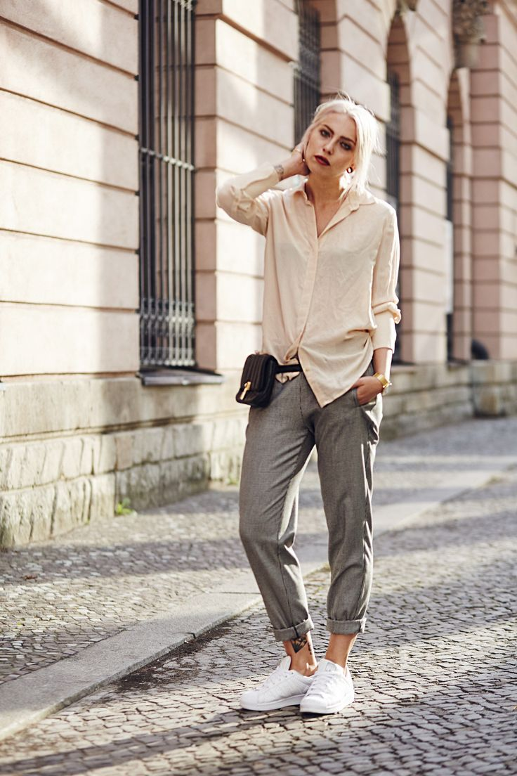 street style from Berlin via Masha Sedgwick | casual office fashion outfit | Masha is wearing Adidas Superstar sneaker, a black Elizabeth & James belt bag, a golden hand cuff, a nude silk shirt, a hound's-tooth checked pants
