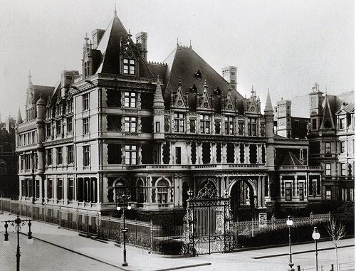 """Cornelius Vanderbilt II purchased and demolished 3 brownstone houses on the southwest corner of 57th Street and 5th Avenue in preparation for his new mansion. His wife was instrumental in the extravagance–it was """"common belief that Alice Vanderbilt set out to draft her sister in law [Alva Vanderbilt]'s Fifth Avenuechâteau, and dwarf it she did."""" Incredibly, in the 1890's,he purchased 5 more brownstones to demolish and expand his mansion."""