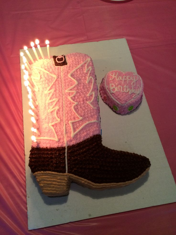 Cowgirl boot cake and small cake for the birthday girl. Homemade buttercream except the dark brown is pillsbury chocolate fudge. Small cake is a 2 layer made with heart-shaped pan from easy bake oven. :)
