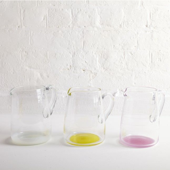Water pitcher in colourless glass with a fun coloured base, hand-blown by Michael Ruh & featuring beautifully scribed lines within to create texture and form.