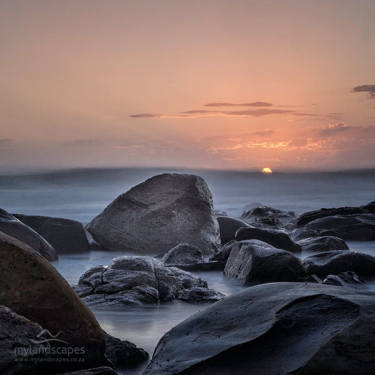 rocks at sunrise. the point, mossel bay, garden route, south africa