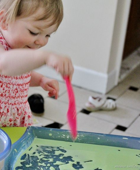 Corn starch and water sensory play is one of my favorite ways to get rid of grumpy moods, and to keep my kids busy on stormy weather days.