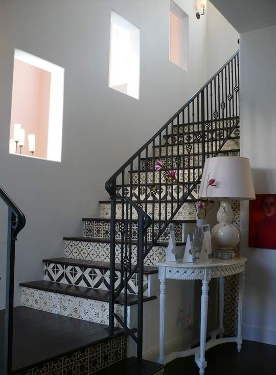 Decorative tiles on stairs, looks amazing!