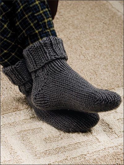 These cuffed men's slipper socks are made extra-toasty with chunky yarn. This e-pattern was originally published in Knit a Dozen Plus Slippers. Size: Includes men's small through large. Made with bulky (chunky) weight yarn, size 11 (8mm) double-pointed needles and size J (6mm) crochet hook. Skill Level: Intermediate