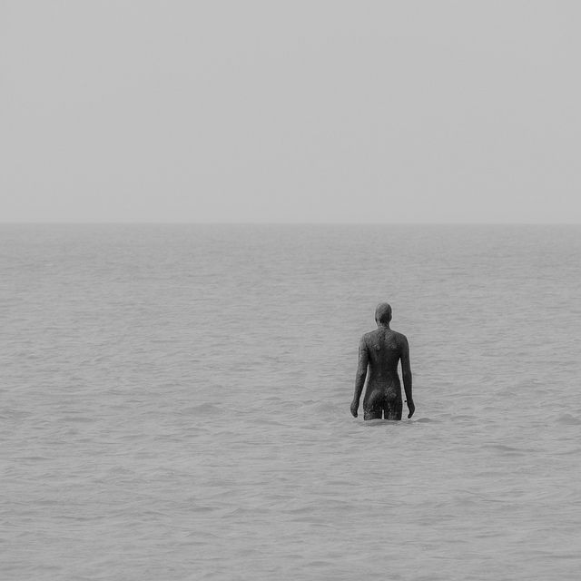 Fine Art   Sculpture   Anthony Gormley statue at Crosby