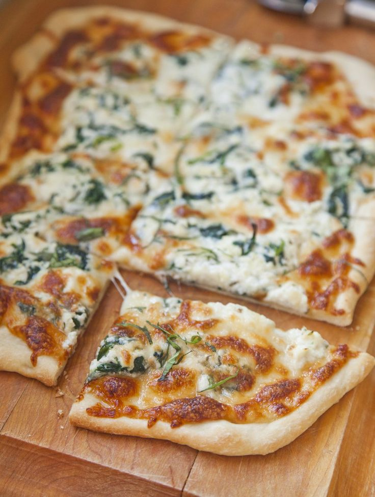white pizza with spinach and basil