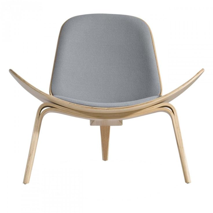 Designed In The Shell Chair Uses A Wing Shaped Seat And A Curved Backseat,  Resting Elegantly On A Three Legged Base, As If It Was Made Of Shells.
