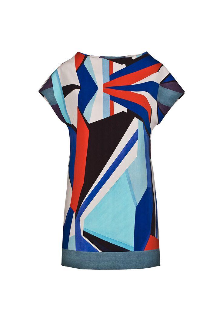 Платье свободного кроя с короткими рукавами и широким вырезом. Геометриный принт в духе эпохи модернизма.