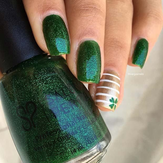Green sparkle is ideal for St Patrick's day! These next nails utilize dim green sparkle with one highlight nail. The intonation nail has a stripped example and a little good luck charm. There are instructional exercises to help you with stripes, shamrocks, and clovers so you could reproduce this take a gander at home. Nails like these will likewise look beautiful after the festivals in light of the fact that the clover configuration is unobtrusive.