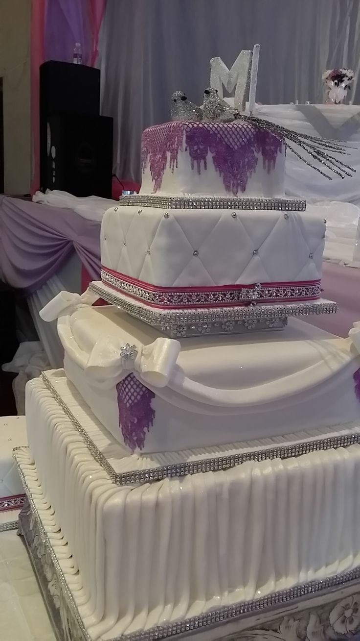Purple and white bling wedding cake. With edible lace. www.helens-cake-craft.co.za