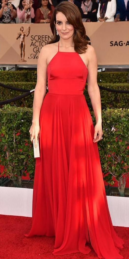 Radiant in red. Tina Fey wears a vermillion silk chiffon halterneck gown from the Prabal Gurung Spring 2016 collection to 22nd annual Screen Actors Guild Awards.. Shop this look on Huew.
