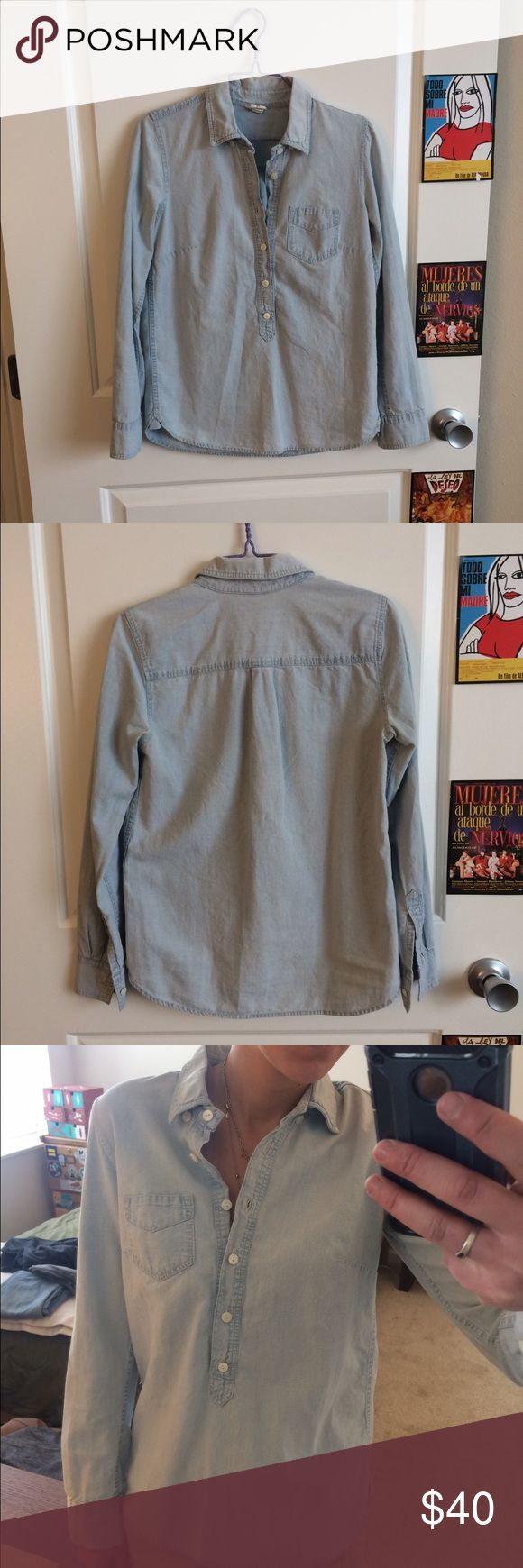 J. Crew Button-Down Denim Long Sleeve Top - XXS J. Crew Long Sleeve collared top that buttons halfway down. Cotton in a light blue denim color. Great casual top. Worn moderately, but great condition. Not sure if it's a flaw, but the fabric around the top buttons crinkles so you have to iron it if you want them out. Size XXS. Fits like an XS or S J. Crew Tops Button Down Shirts