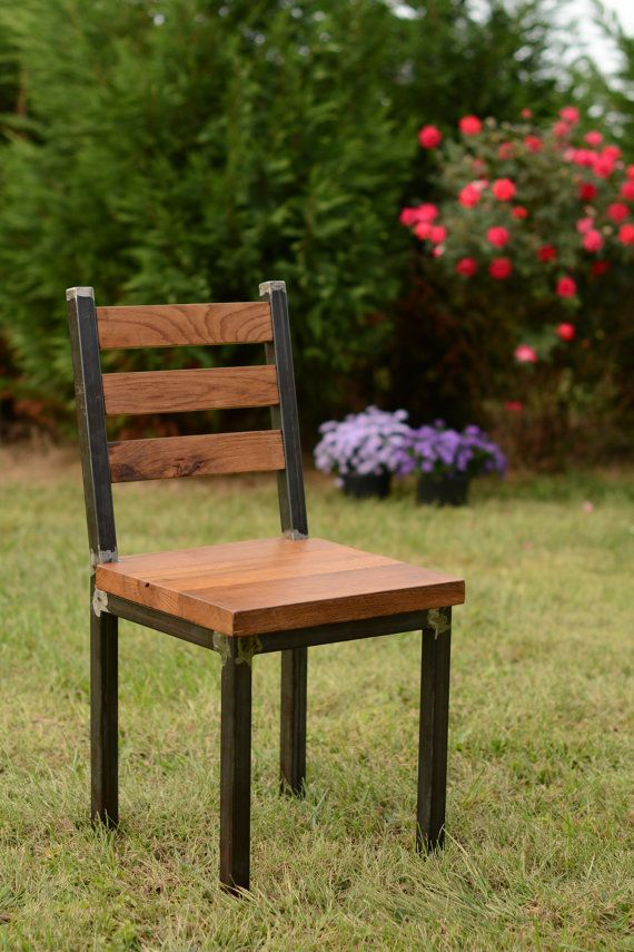 This chair is made from reclaimed barn lumber and a welded frame. The chair has a seat height of 18 inches. A hand rubbed walnut oil finish is