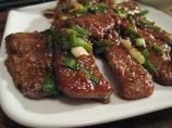 "PF Changs Mongolian Beef - VERY close knock off - slice beef thin and make oil super hot in wok to be more ""crispy"" and authentic."