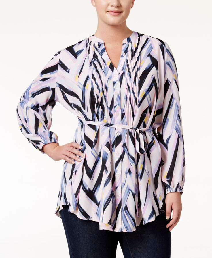 Bold chevron stripes shine the spotlight on Melissa McCarthy Seven7's haute plus size tunic. | Polyester | Machine washable | Imported | V-neckline | Button closures at front | Pintucked details at