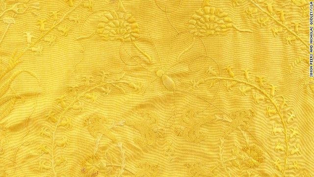 A golden cape woven from the silk of 1.2 million Golden Orb spiders has gone on display at London's Victoria and Albert Museum.  The richly-embroidered garment -- its bright yellow hue is the natural color of the spider silk -- is the result of a seven-year project on the Indian Ocean island of Madagascar.  Using long poles, a team of 80 people worked to collect the spiders from their webs each day and harvest their silk before returning them to the wild.