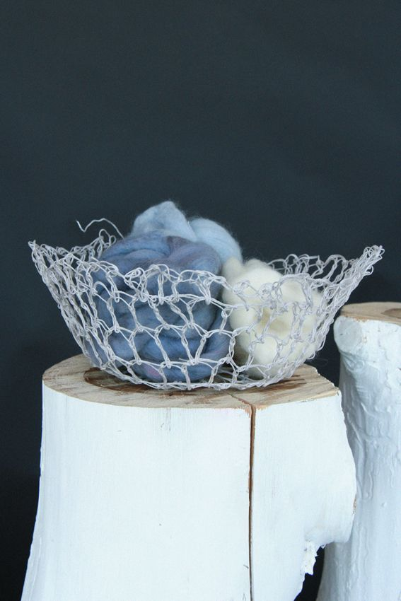 Our vessels are hand crochet from Australian cotton and cast in a sustainable bio-resin. 10cm high, 30cm wide. Available in orange, navy or grey.