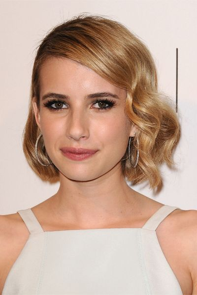 We have serious bob envy in the case of Emma's sleek, shiny cut. Long layers and face-framing curls are flattering and unexpected on this abbreviated length. via @stylelist