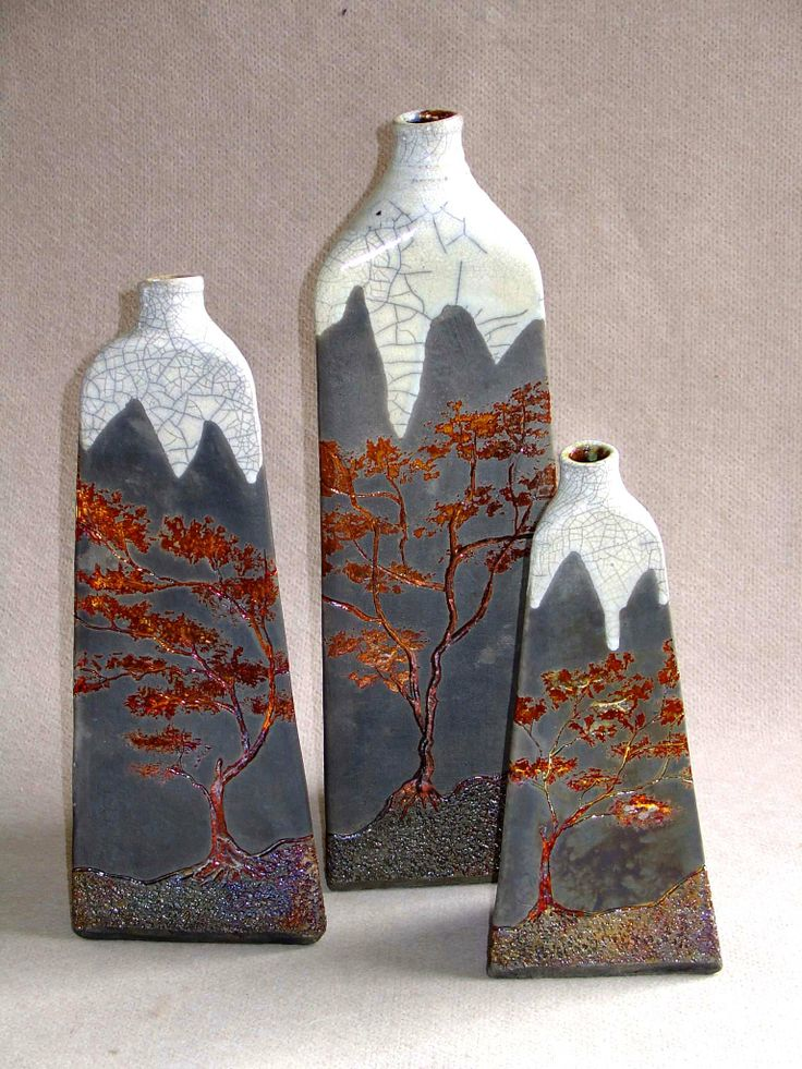 Raku fired 3 sided vases. Made By M.WeinCopper peny and white raku glaze fired to 1100c