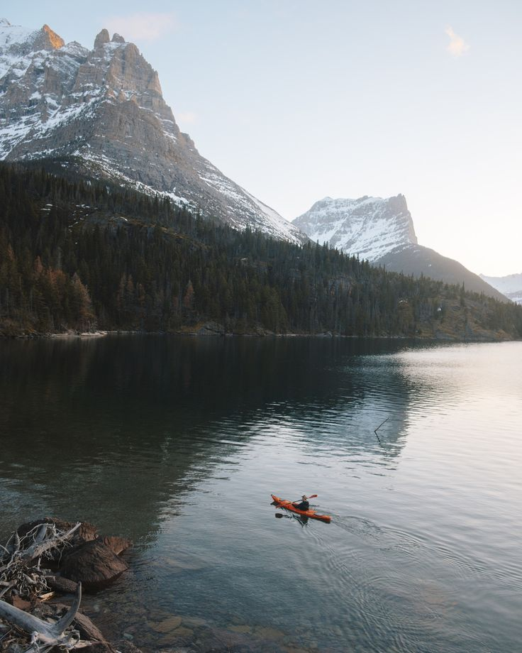 alexstrohl:   Paddling the far end of St Mary Lake in Glacier Park Montana. Just behind me stood the remains of an old cabin cant imagine how it must have felt to wake up here.   Daily images on Instagram: Alex Strohl Behind the scenes on Snapchat: alexstrohl