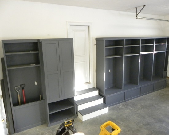 No space inside? Create a mudroom in the garage using bookcases on top of storage benches