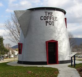 One of Pennsylvania's premier examples of programmatic architecture along the Lincoln Highway is the Coffee Pot. The shape of the building is what drew the public to the small lunch stand. Built in 1927 by David Koontz, the Coffee Pot remains one of only five coffee/tea pot shapes structures left in the United States, a significant decrease from fifteen. Unfortunately, the Coffee Pot was named to the 2001 list of the Commonwealth's Most Endangered Historic Properties.