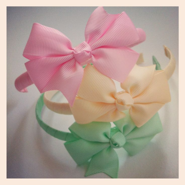 Scrumptious pinwheel bow headbands available from BabyDonkie