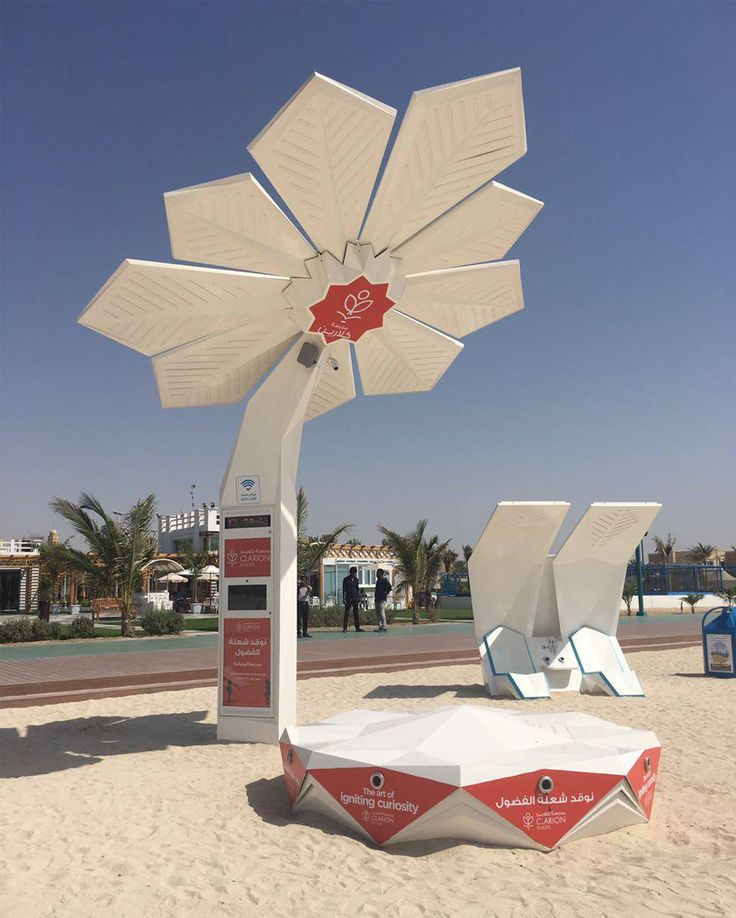 sprouting across dubai in time for the world expo 2020, the solar powered \'smart palm\' trees enable visitors to surf the web whilst at the beach.