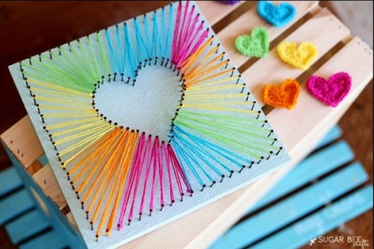 How gorgeous is this Rainbow String Heart Art and it's so easy to create. Be sure to view all the beautiful versions now!