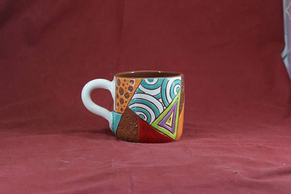 Mug ideal for warm or cold drinks.  This object is made of low-temperature clay, the technique Sgraffito and many different dots colors. The object is suitable for food, microwave and dishwasher.  weight=300 gram height=8,5 cm