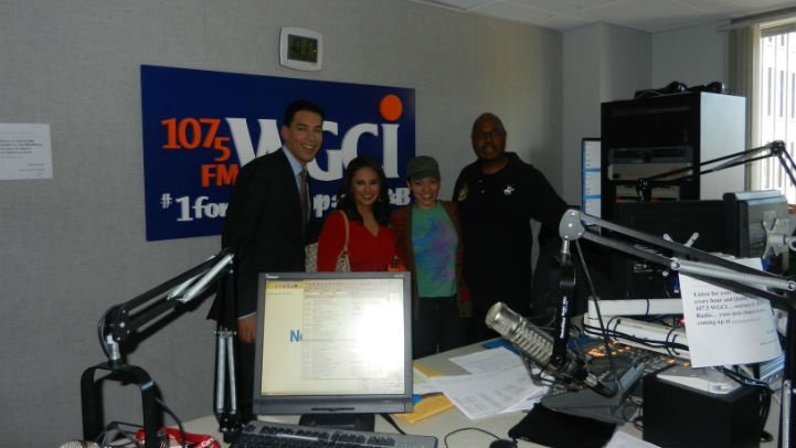 Stefan Holt and Daniella Guzman pose for a picture with WGCI midday host Loni Swain and talk show host Ty Wansley. -- The interview will air Saturday, May 12 @ 7am on Inspiration 1390AM and Sunday, May 13 @ 7am on WGCI 107.5FM.