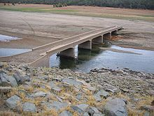 The Salmon Falls Bridge, normally at the bottom of Folsom Lake, CA. Since the construction of Folsom Dam in the 1950s (which created Folsom Lake) Salmon Falls is typically immersed in water.  Record low lake levels have again brought it to light.