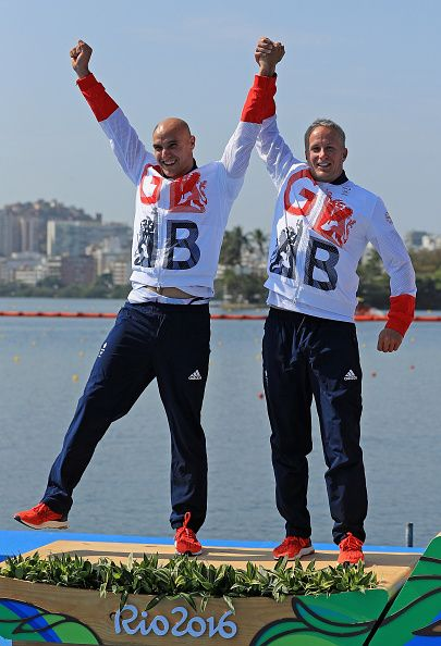 Silver medalists Liam Heath and Jon Schofield of Great Britain stand on the…