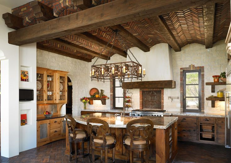 vaulted ceiling in spanish revival.  But that's not why I pinned this.  It has the same juxtaposition of center island with sink opposite the range with vent hood.  Windows on that wall.  Hutch.