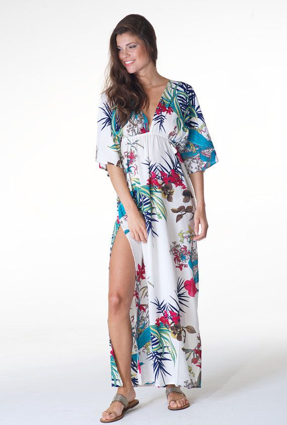 WAS $57.50. This is a romantic sweet tunic! This silky soft boho chic long kaftan / cover-up has colorful tropical floral motif print pattern. V-neck front and back (with ties to keep in place, decorative beads). Slits at sides. Empire elastic waist. Super comfortable! Wear it to the beach / pool party, cruise festival parties, for a walk, brunch with friends, or lounging in the house. Effortlessly cool and charming. Material: Premium Quality Polyester (silk soft!) ** In stock. Ship…