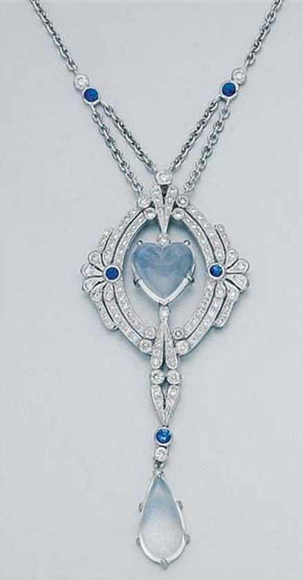 White Gold, Moonstone, Diamond and Sapphire Lavaliere 18 kt., ap. 8.8 dwt. Length 16 inches. Edwardian or Edwardian style.