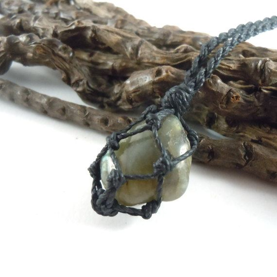 A cute Labradorite crystal wrapped in a macrame necklace and the result is a beautiful jewel that goes with any lifestyle due to its simplicity! We love it!!!     LABRADORITE,the magic friend.    Transformation. Strength. Enlightenment. Intuition. Imagination. Creativity. Enthusiasm. Clarity. Energy. Discernment. Freedom. Shield. They all could be synonyms for Labradorite or 'Old Warrior's Stone' or the 'Firestone'. This stunning unusual  mineral works in several directions, bringing light…