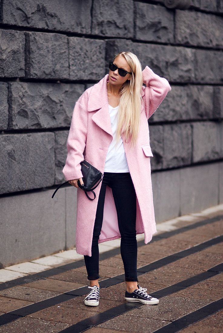 pink coat & chucks. cool. #VictoriaTornegren in Stockholm.