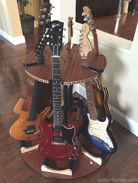 The Carousel™ Deluxe Multi Guitar Stand fits 6 guitars in just 3 feet of space! View details at https://guitarstorage.com/shop/multiple-guitar-stand-carousel