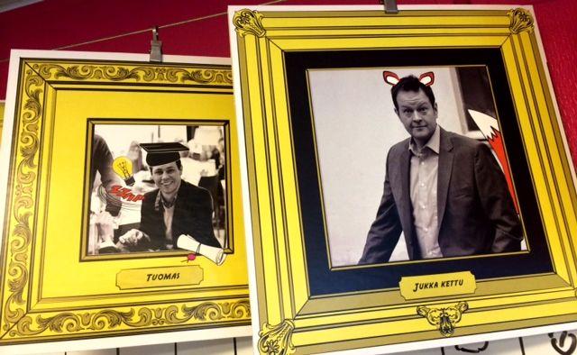 Yrityksen johtoa kuvattuna toimiston seinällä HiQmaiseen tyyliin. Näiden tyyppien kanssa myös HR:n pitäisi tulla toimeen.  Jukka toimitusjohtaja ja Tuomas varatj.