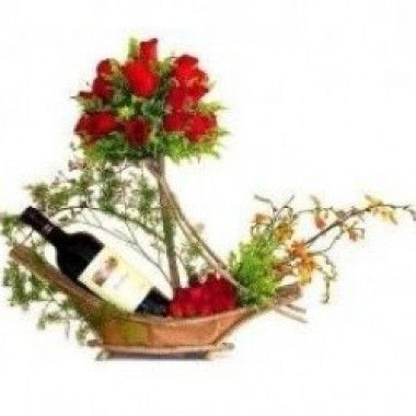 beautiful basket with wine and red roses